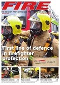 Cover of FIRE magazine showing two firefighters in full gear