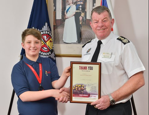 youngster raises money for firefighters charity