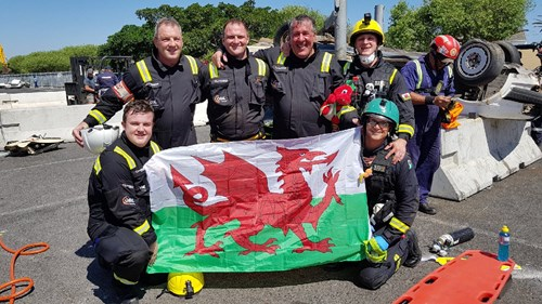 team of firefighters with welsh flag